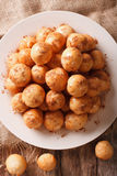 Greek loukoumades donuts with honey and cinnamon closeup. Vertic Stock Photography
