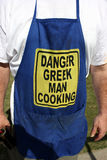 Greek man cooking Royalty Free Stock Image