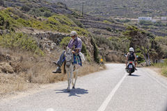 Greek man on mule. Amorgos island, Greece Royalty Free Stock Photography