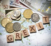 Greek map, euros and drachma grexit letters from above Stock Photo