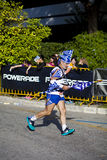 Greek Marathon Athlete. Athens, Greece - November 09, 2014: A Greek marathon runner at the street of Athens as he runs the classical marathon Royalty Free Stock Images