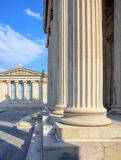 Greek marble pillars infront of a classical building Stock Photos