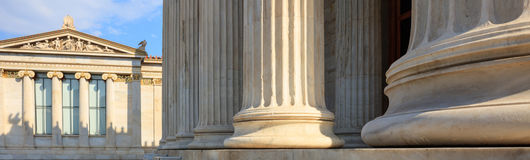 Greek marble pillars infront of a classical building Royalty Free Stock Photos