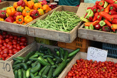Greek market stall. Vegetables on sale at a greek market stall - okra, cucumber,cherry tomatoes, plum tomatoes, capsicums and peppers royalty free stock images