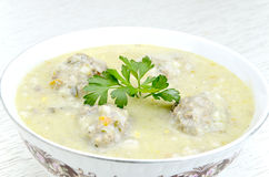 Greek meatball soup in bowl. Greek meatball soup, known as youvarlakia, in bowl Stock Image