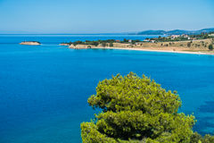 Greek mediterranean coast with beautiful blue tones of Aegean sea in Sithonia Royalty Free Stock Image
