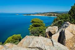 Greek mediterranean coast with beautiful blue tones of Aegean sea in Sithonia Stock Photos