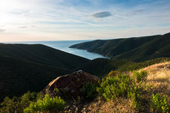 Greek mediterranean sea coast at sunrise in Macedonia Royalty Free Stock Image