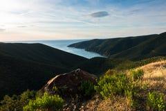 Greek mediterranean sea coast at sunrise in Macedonia Royalty Free Stock Image