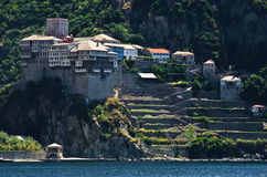Greek monastery on a coast of aegean sea below the holy mountain Athos Stock Photography