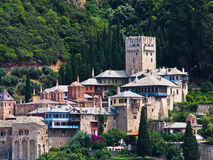 Greek monastery on a coast of aegean sea below the holy mountain Athos Royalty Free Stock Photography