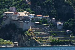 Greek monastery on a coast of aegean sea below the holy mountain Athos Royalty Free Stock Images