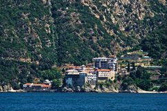 Greek monastery on a coast of aegean sea below the holy mountain Athos Stock Photo