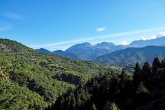 Greek Mountain Pine Forests, Greece. A Greek mountain landscape with layered mountains covered with pine forests, from dark green to hazy blue in the distance stock photography