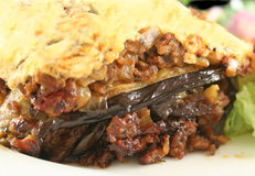 Greek Moussaka. Lamb moussaka with egg plant cheese and salad stock images