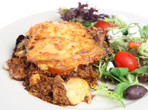 Greek Moussaka with Salad. Traditional Greek moussaka made with aubergines and served with a Greek salad Royalty Free Stock Image