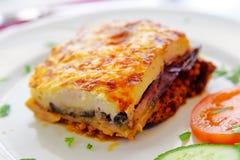 Greek moussaka. Greek style moussaka with eggplants, ground beef and potatoes. Horizontal shot stock image