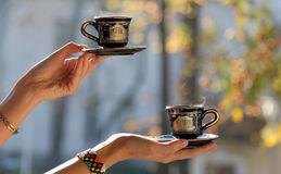 Hands serving coffee Royalty Free Stock Photo