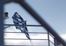 Greek National Flag waving in the sky royalty free stock images