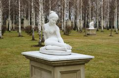Marble nude statues in the cold season Royalty Free Stock Images