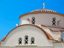 Greek old church with brown roof over blue sky Royalty Free Stock Images