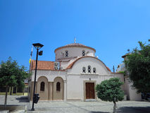 Greek old church with brown roof over blue sky Stock Photo
