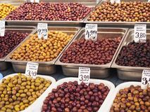 Greek Olives displayed in Athens Street Market. Olives, the staple of Greek cuisine, are displayed in a huge variety in the Marketplace in Athens, Greece Stock Photos