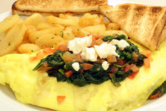 Greek Omelet. This is an image of a greek omelet with potatoes and toast royalty free stock photo
