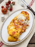 Greek omelet with tomatoes. And feta Royalty Free Stock Photo