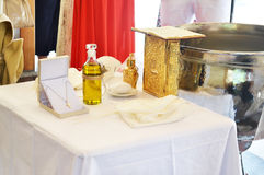 Greek Orthodox christening - baptism oil, gold cross and soap royalty free stock photography