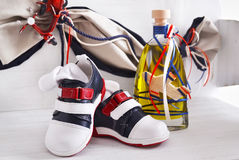 Greek Orthodox christening objects - baby shoes and the baptism oil royalty free stock image