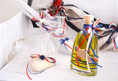 Greek Orthodox christening objects - baptism oil, soap and candles stock image