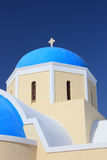 Greek orthodox church. Traditional Greek white church arch with cross and bells in village Oia of Cyclades Island Santorini Greece Stock Image