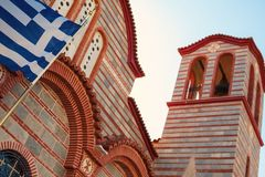 Greek Orthodox Church. Details of Greek Orthodox church, part of building with focus on national flag Royalty Free Stock Photos
