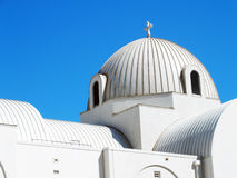 Greek Orthodox Church. Dome of a Greek Orthodox Church located outside of Dallas, Texas in the town of Richardson.  White church with a blue sky background Stock Photo