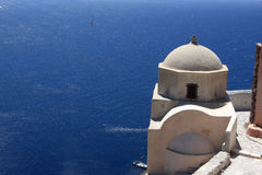 Greek orthodox church on edge of sea Royalty Free Stock Photography
