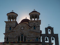 Greek Orthodox Church,  Greece. Greek Orthodox Church and tripple bell tower, Greece, partial silhouette Royalty Free Stock Photo