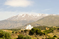 Greek Orthodox Church. On a hill with the bottom of the mountain in the center of Crete Stock Photography