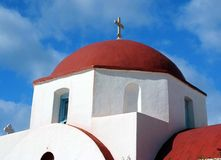 Greek Orthodox church in Mykonos, Greece. Red domed white Orthodox church in Mykonos, Greece. Brilliant blue sky stock photo