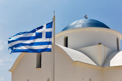Greek orthodox church with national flag in Paphos, Cyprus. Royalty Free Stock Photo