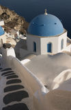 A greek orthodox church in Oia with sea background, Santorini. Greece Royalty Free Stock Photo