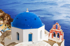 The Greek Orthodox Church in Oia town on Santorini island in Greece Stock Images
