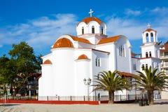 Greek orthodox Church in Paralia Katerini beach, Greece. Greek orthodox Church in Paralia Katerini, palm trees and sandy beach, Greece Royalty Free Stock Image