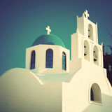 Greek orthodox church in Santorini. Vintage style. Stock Photos