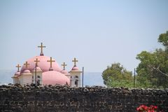 Greek Orthodox Church of the Seven Apostles outside the reconstructed archaeological wall of Capernaum stock images