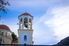 Greek orthodox church. Tower bell with blue sky on the background Stock Photos