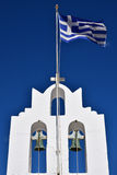 Greek Orthodox Church. With two bells, cross and flag flapping against a clear blue sky. Sifnos - Greece stock photo