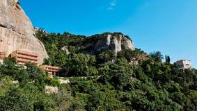 Mega Spilaio Monastery, Kalavryta, Peloponnese, Greece. The Greek Orthodox Mega Spilaio Monastery, Kalavryta, Greece, with bare rocky cliffs and a clear blue sky stock photography