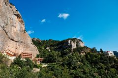 Mega Spilaio Monastery, Kalavryta, Peloponnese, Greece. The Greek Orthodox Mega Spilaio Monastery, Kalavryta, Greece, with bare rocky cliffs and a clear blue sky royalty free stock image