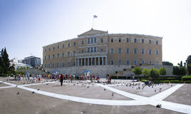 Greek parliament, Athens. The building of the Greek parliament in Athens. People are watching the traditional guards (evzones&#x29 Stock Photos
